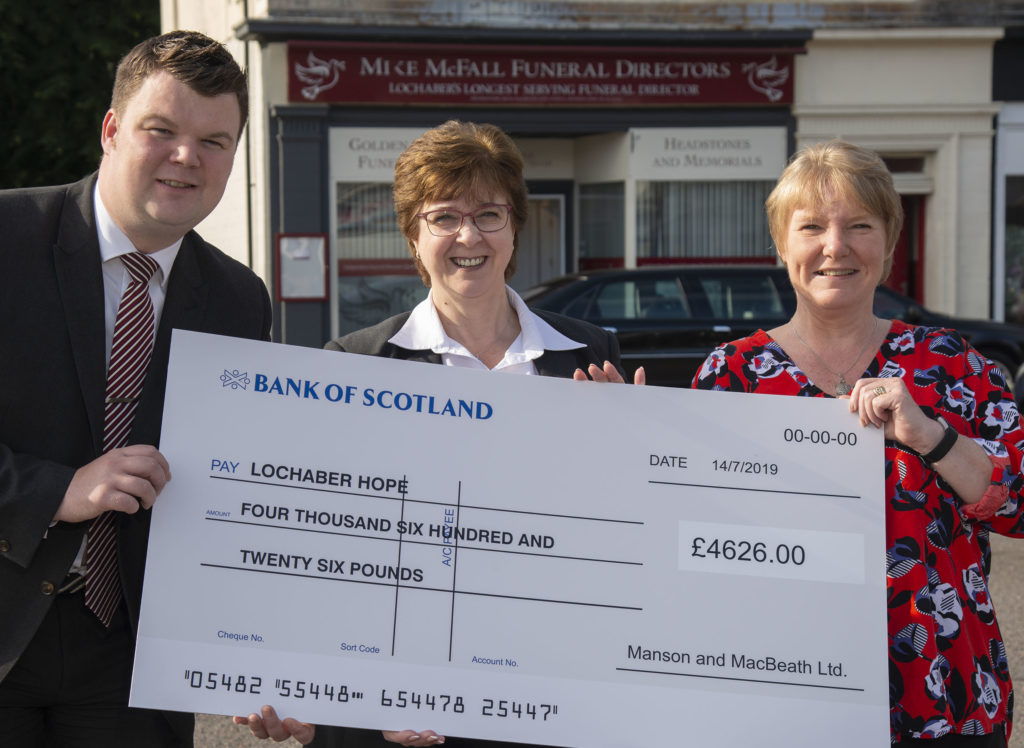 McFall Funeral Directors hand over £4,626 cheque to Lochaber Hope