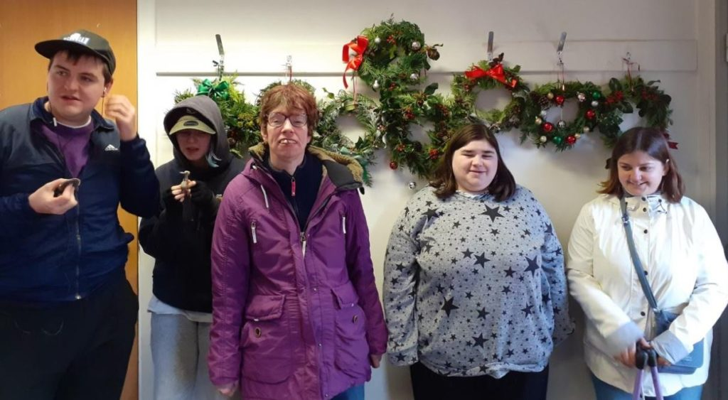 Merry makers sell wreaths at festive fair