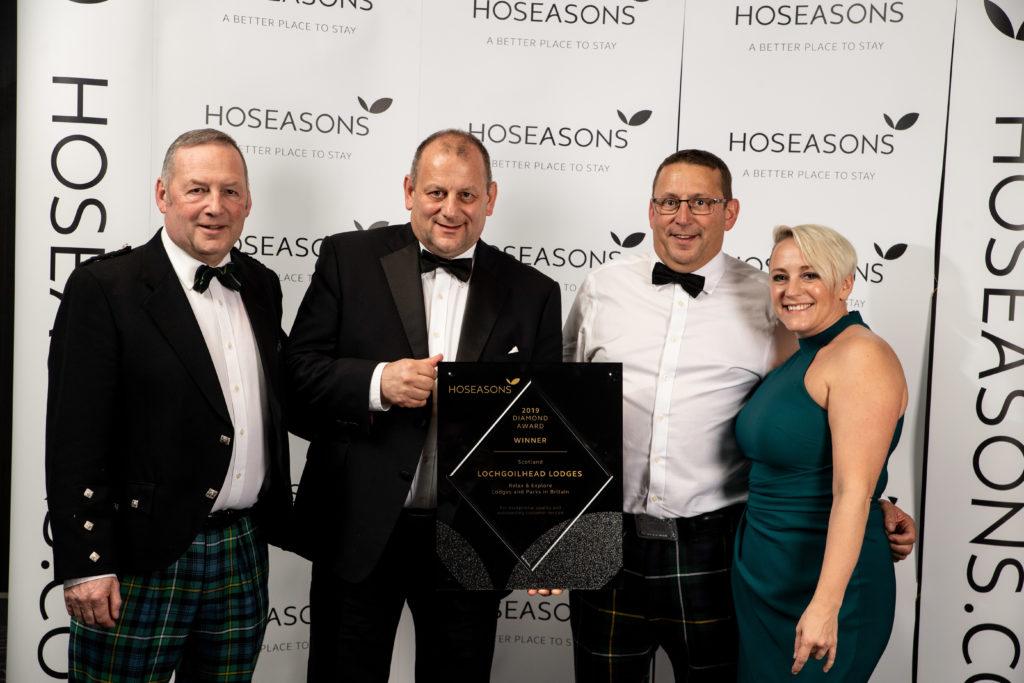 Lochgoilhead Lodges team, Allan Campbell, Keith Campbell and Roy Campbell, receive their award Hoseasons property and portfolio director Hayley Johnson