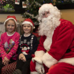 Bailey-Mary and Paige Morrison were the first visitors to Santa's Grotto in Costa Coffee Photograph: Iain Ferguson, alba.photos NO F49 STREET FESTIVAL SANTAS GROTTO