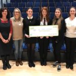 Lochaber High School pupils, Tamzin, Faye and Laura, centre, won the money for Care Lochaber. NO F50 YPI