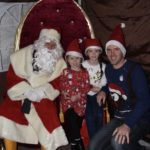 Andrew Maclean with Olivia and Emm enjoy a visit with Santa. NO-F51-Kyle-RNLI-Andrew-Maclean-with-Olivia-Emma.jpg