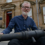 Paul Rigby with the cannon. PHOTOGRAPH: IAIN FERGUSON, THE WRITE IMAGE. NO F02 BONNIE PRINCE CANNON 01